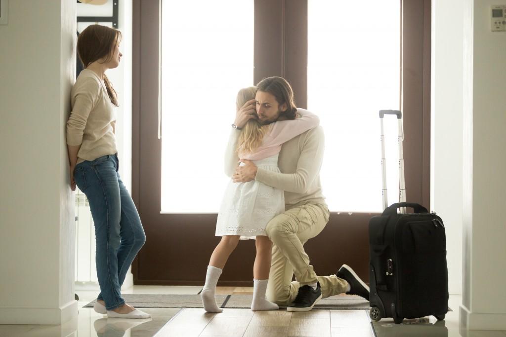 Man hugging his daughter