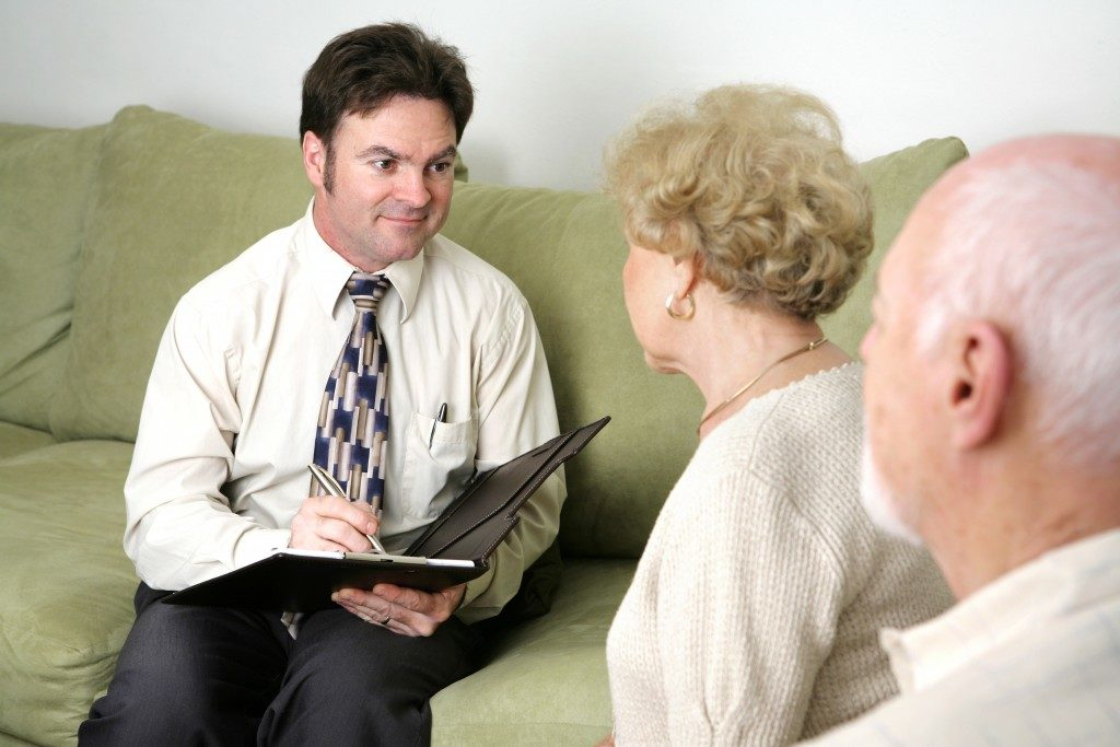 elderly woman and man with funeral planner