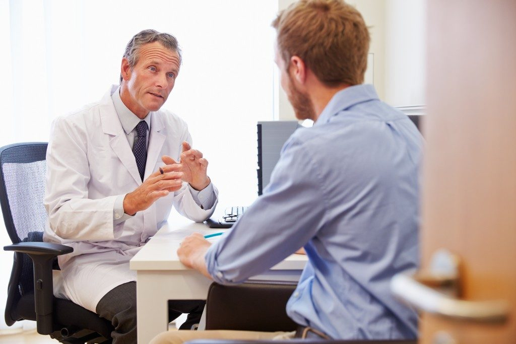 Doctor with patient consultation
