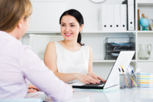 woman speaking with a client