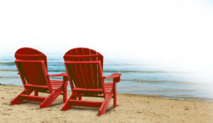 couple seats by the beach